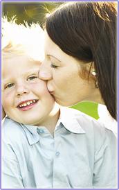 mom kisses child